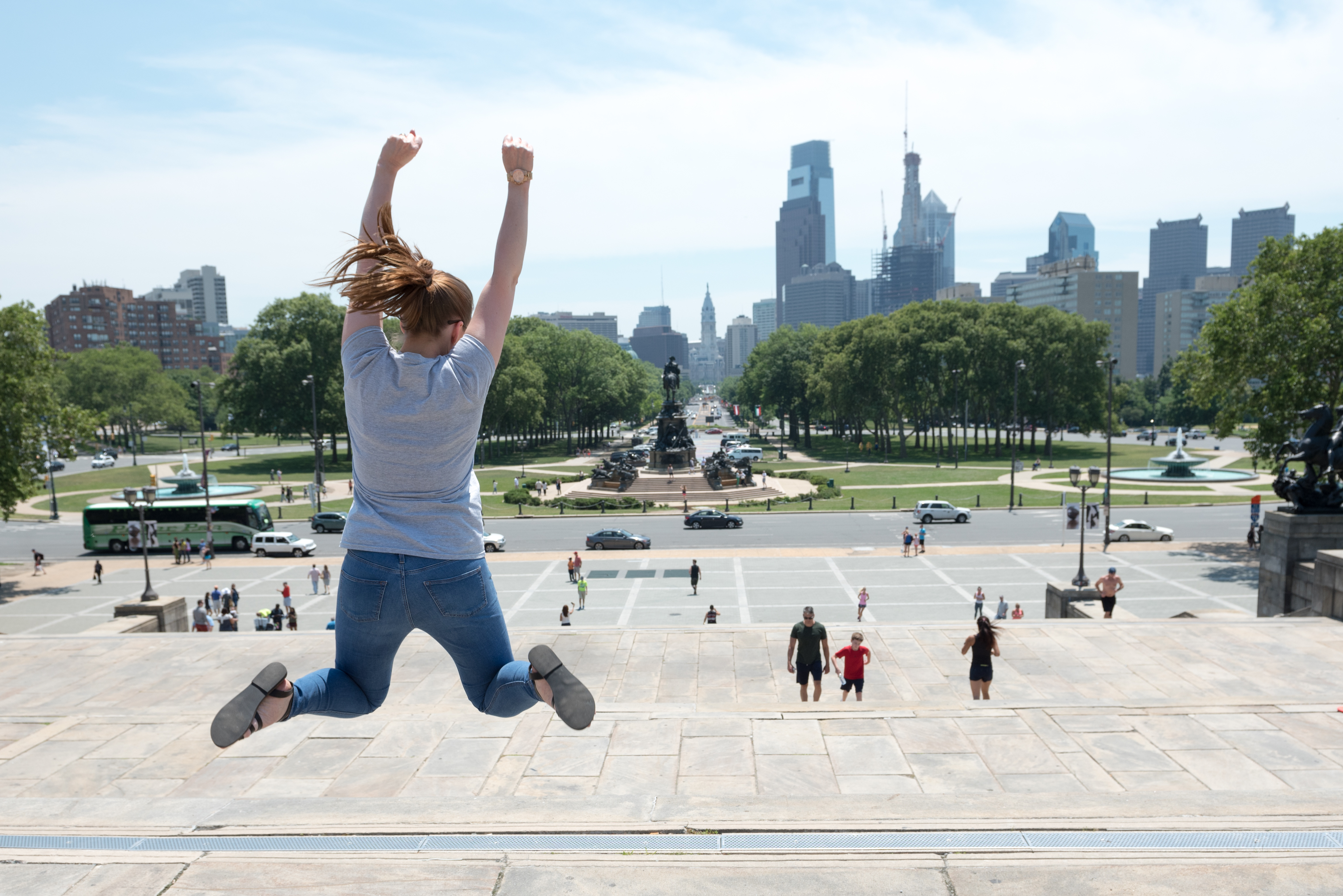 Student jumping atop Rocky Steps in Philadelphia